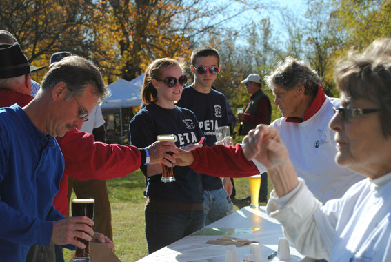 Volunteers pouring and serving craft beer from Starr Hill of Charlottesville and Legend Brewery of Richmond