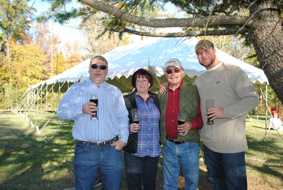 Festival goers (from right to left) Kipp Burch, Judy and Jerry Peak, and Ryan Enoch enjoying the beer from Legend Brewery